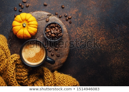composite image of orange mug and coffee beans stock photo © wavebreak_media