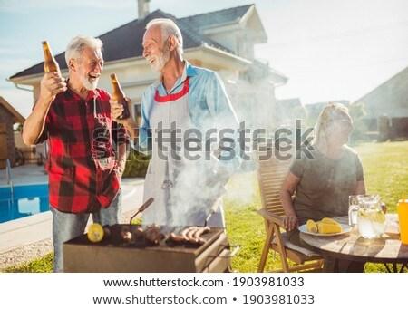 Man smoking while having beer Stock photo © wavebreak_media