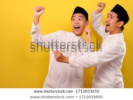 young muslim happy man gesturing stock photo © rastudio