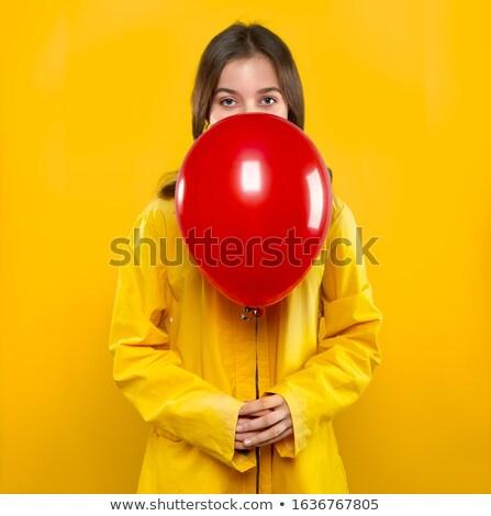 довольно девушки желтый пальто красный воздушный шар Сток-фото © LoopAll