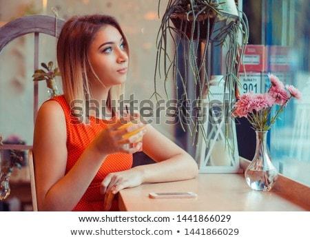 Fiatal mosolyog szőke nő álmodozás büfé Stock fotó © pressmaster
