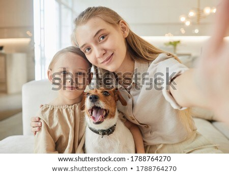 Woman on sofa with dog Stock photo © photography33