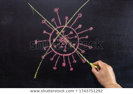 Crossing out crisis on a green chalkboard Stock photo © bbbar