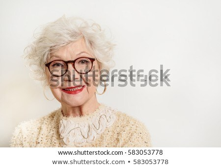 Elegant woman in glasses standing and posing Stock photo © dariazu