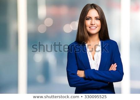 portret · glimlachend · jonge · zakenvrouw · heldere · kantoor - stockfoto © Minervastock