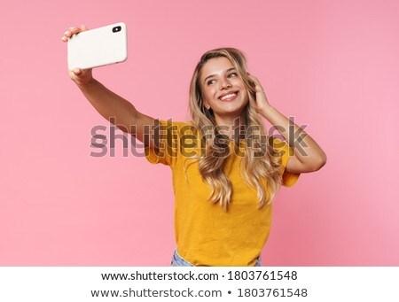 Kobieta odizolowany różowy mówić telefonu komórkowego Fotografia Zdjęcia stock © deandrobot