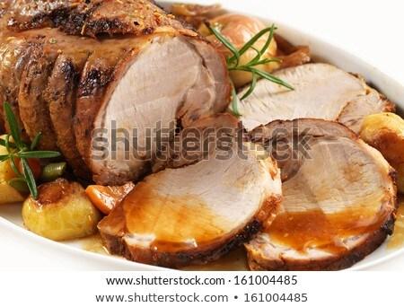 Sliced roast pork tenderloin with potatoes and carrots Stock photo © Melnyk