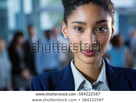 Portrait of happy young pretty mixed race businesswoman looking at camera during seminar in office b Stock photo © wavebreak_media