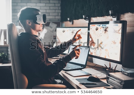 creative man in virtual reality headset at office Stock photo © dolgachov