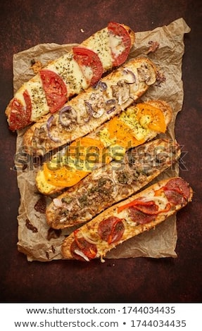 Assortment of various toppings baked sandwiches. With melted che Stock photo © dash