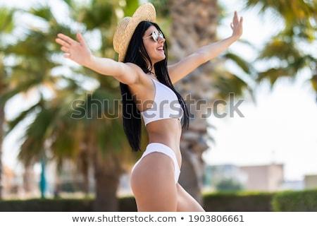 Boldog fiatal nő bikini ököl pumpa nyár Stock fotó © dolgachov