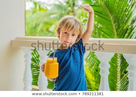 Jongen drinken sappig smoothie mango glas Stockfoto © galitskaya