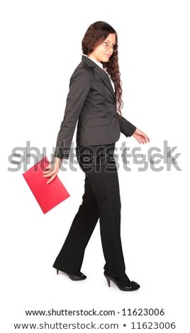 beautiful brown-haired woman goes with red folder Stock photo © Paha_L