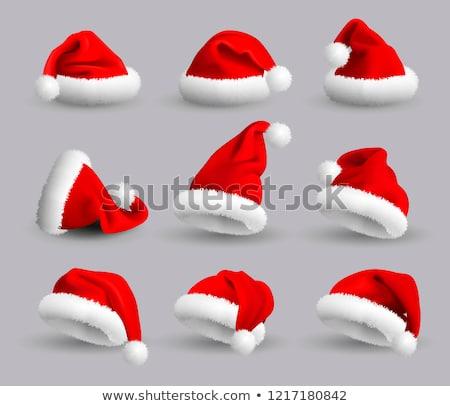 red santa claus hat on white background stock photo © ozaiachin