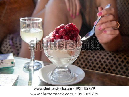 Cute lady eating a fruit ice-cream Stock photo © konradbak