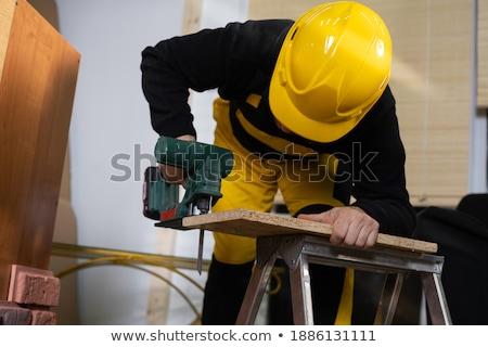 Construction helmet in wooden cabinet Stock photo © stevanovicigor