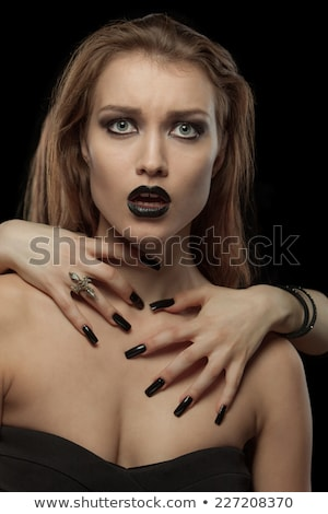 pretty gothic brunette woman with hands on neck stock photo © master1305