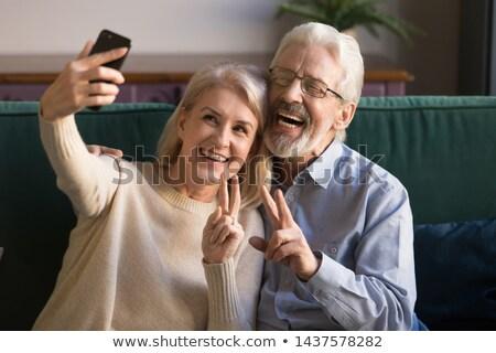 senior woman taking selfie by smartphone at home stock photo © dolgachov