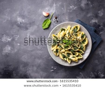 Conchiglioni pasta with spinach in creamy sauce Zdjęcia stock © furmanphoto