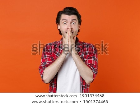 shocked boy in red t-shirt closing mouth by hands Stock photo © dolgachov