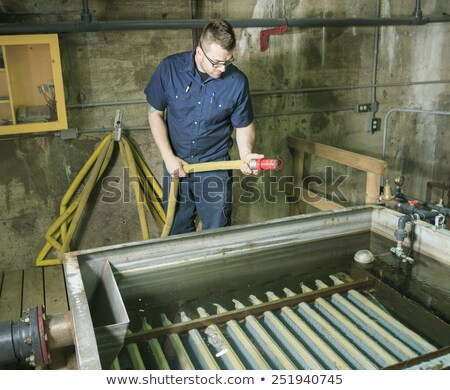Wastewater aeration basin bubbling in a building Stock photo © Lopolo