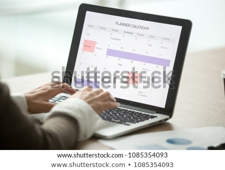 Africano mulher agenda calendário programar aplicativo Foto stock © AndreyPopov