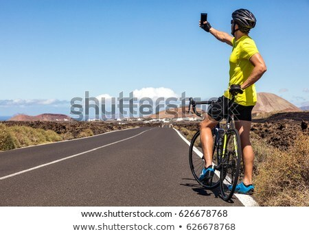 Cyclist tourist taking selfie on biking vacation Stock photo © Maridav