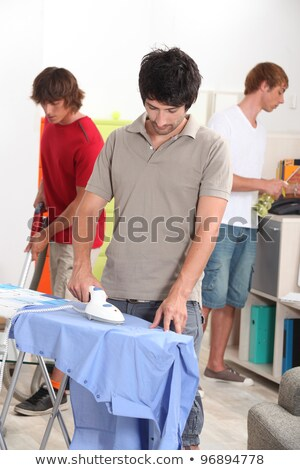 Three young housemates doing the chores Stock photo © photography33