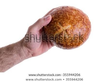 Male hand giving a sourdough bread roll Stock photo © ozgur