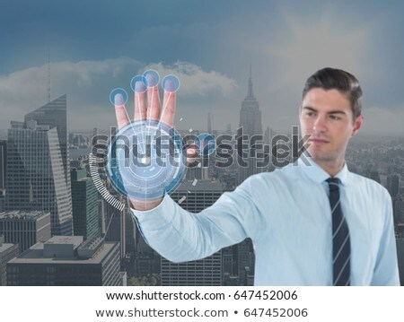 Stock fotó: Business man with hand scan in front of the city