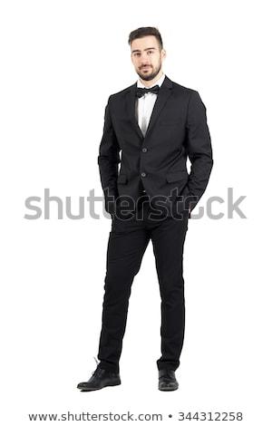 portrait of young stylish man wearing black tuxedo and bowtie Stock photo © feedough