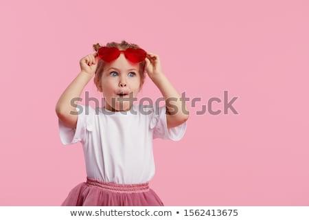 Legal criança estúdio doce menina óculos de sol Foto stock © lichtmeister