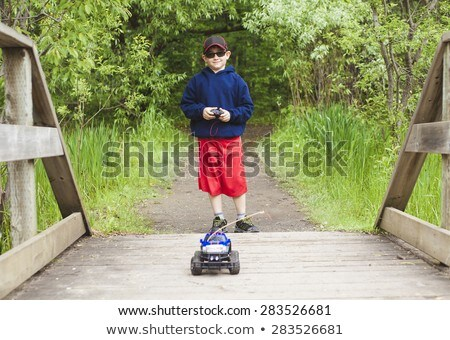 boy play electric truck Stock photo © Lopolo