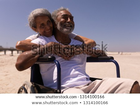 Front view of woman embracing disabled senior man on beach in the sunshine Stock photo © wavebreak_media