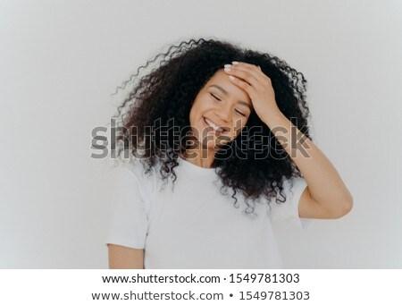Foto gelukkig dame hand voorhoofd hoofd Stockfoto © vkstudio