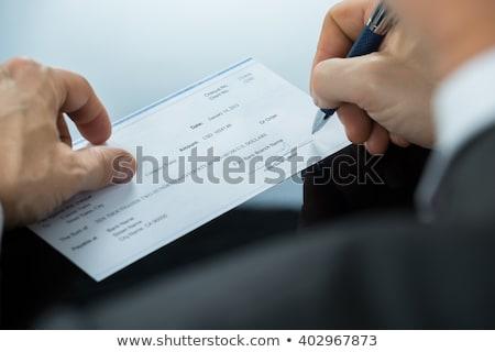 бизнесмен заполнение проверка столе Сток-фото © AndreyPopov