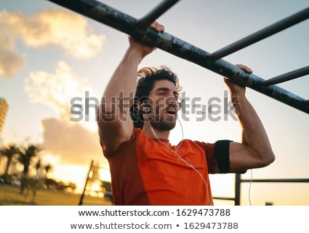 Jonge mannen oefening triceps sport fitness gezondheid Stockfoto © Jasminko