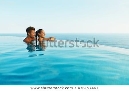 Zwembad paar ontspannen luxe resort reizen Stockfoto © Maridav