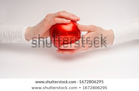 woman holding red balls Stock photo © imarin