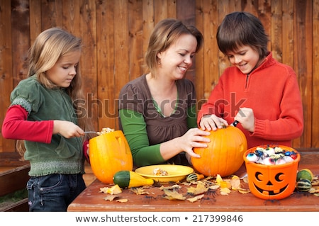 Parents carving a pumpkin with their daughter Stock photo © photography33
