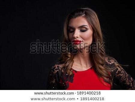 Nő vörös ruha piros ajkak néz komoly arc Stock fotó © wavebreak_media