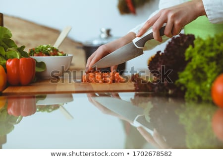 Close-up of human's hand cooking food Stock photo © bmonteny