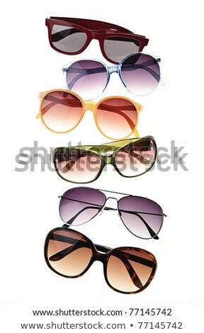 Assorted styles of tinted sunglasses on white background Stock photo © dashapetrenko