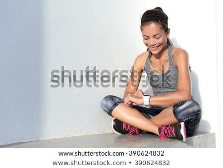 Woman using activity tracker Stock photo © deandrobot