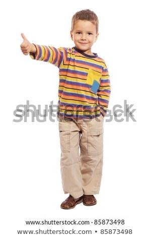 Küçük erkek ayakta neden Stok fotoğraf © deandrobot