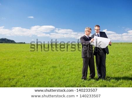Kettő üzletemberek áll mező üzlet üzletember Stock fotó © IS2