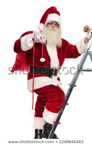 santa steps up the ladder to bring presents for christmas Stock photo © feedough