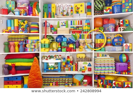 many toys on wooden shelves stock photo © colematt