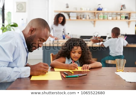 Mother and son draw together at home on kitchen table Stock photo © Lopolo