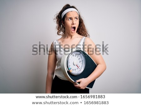 Young Woman On The Weighing Machine Stock photo © Jasminko